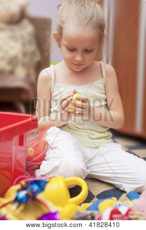 Little Blond Caucasian Girl Playing