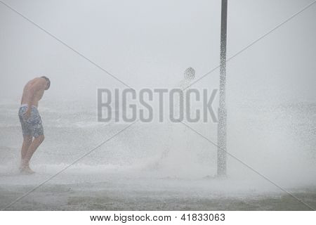 Brisbane, Australia - January 27 : Unidentified Men Brave The Elements During Ex Tropical Cyclone Os