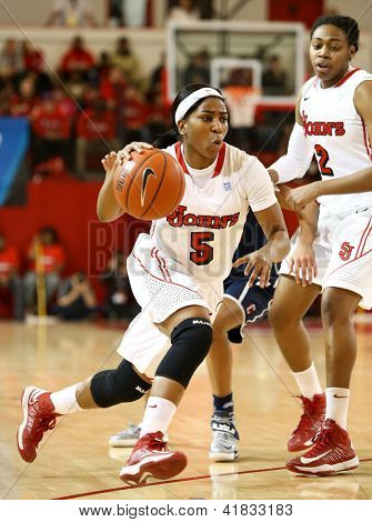 JAMAICA-FEB 2: St. John's Red Storm guard Nadirah McKenith (5) dribbles the ball against the Connecticut Huskies during the first half at Carnesecca Arena on February 2, 2013 in Jamaica, New York.