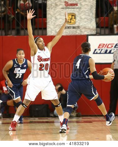 JAMAICA-FEB 2: Connecticut Huskies guard Moriah Jefferson (4) looks to pass around St. John's Red Storm guard Keylantra Langley (20) at Carnesecca Arena on February 2, 2013 in Jamaica, New York.