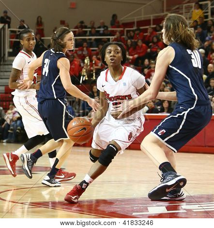 JAMAICA-FEB 2: St. John's Red Storm guard Aliyyah Handford (3) dribbles around Connecticut Huskies forward Breanna Stewart (30) at Carnesecca Arena on February 2, 2013 in Jamaica, Queens, New York.