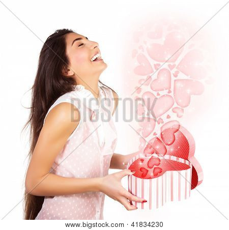 Photo of beautiful woman opened present box, cute female holding in hands open heart-shaped gift isolated on white background, romantic holiday, Valentines day, love concept
