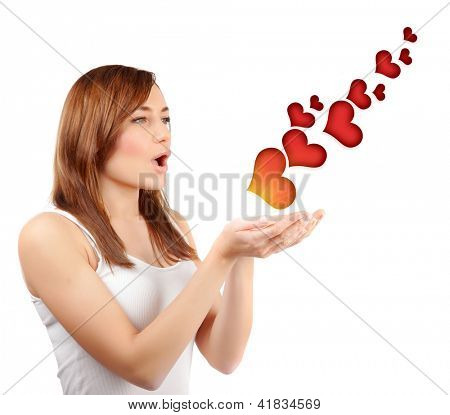 Picture of beautiful woman blowing red hearts isolated on white background, cute female send romantic kiss, Cupid girl, Valentines day, sweet holiday, romance and love concept