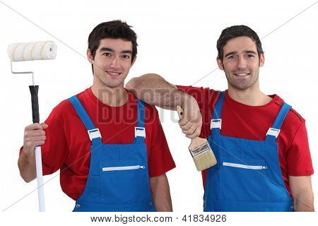 Two painters wearing matching outfits