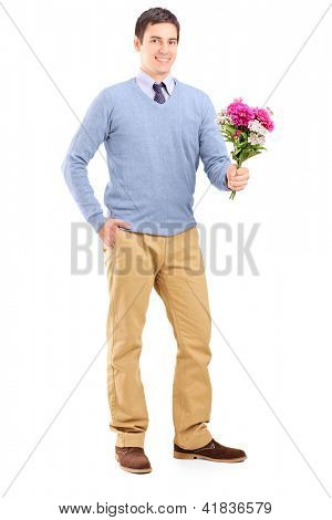 Full length portrait of a young romantic man holding a bouquet of flowers isolated on white background
