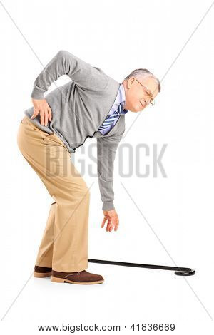 Full length portrait of a senior man with back pain trying to pick up a cane isolated on white background