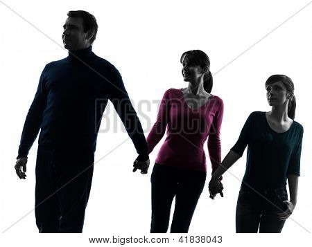 one caucasian family father mother daughter man walking  holding hands in silhouette studio isolated on white background