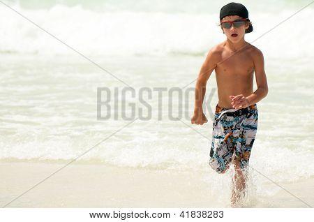 Young Boy Running In Ocean