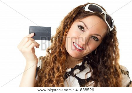 Portrait of young shopping woman holding credit card isolated on white background