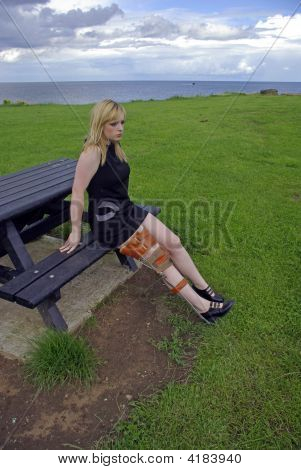 Girl Sitting Wearing Leg Brace