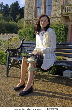 Leg Braced Girl Sitting On Bench