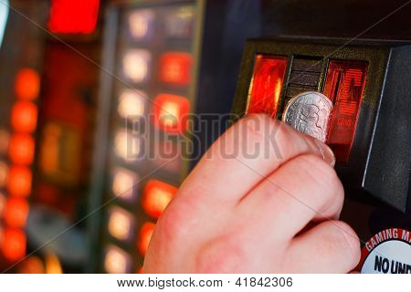 Inserting Coins Into Gaming Machine