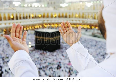 Muslim Arabic man praying at Kaaba in Mecca