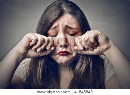portrait of sad young woman crying