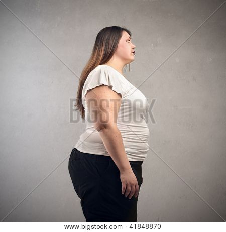 fat woman in profile on gray background