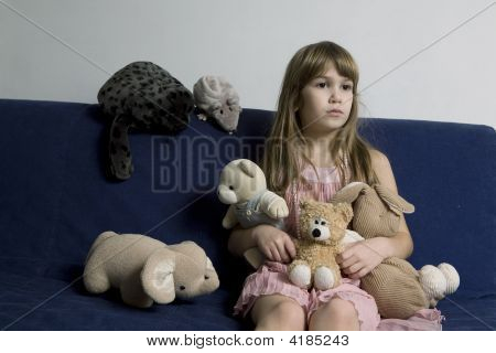 Portrait Of Young Girl With Toys