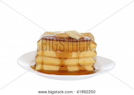 Isolated Waffles with butter and syrup