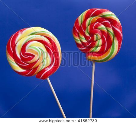 Lollipops over blue background
