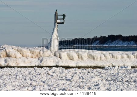 Harbor Light Covered In Snow And Ice