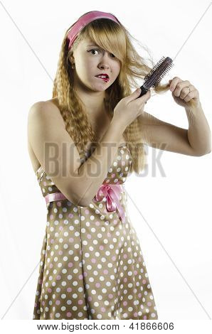 A girl with a hairbrush