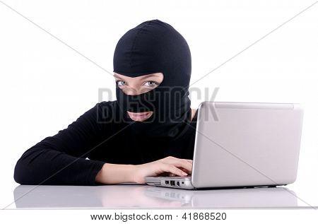 Hacker with computer wearing balaclava
