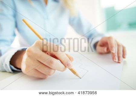 Business person drawing a graph denoting the company�¢??s progress