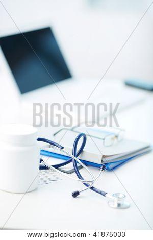 Vertical image of medical stuff being arranged on desk