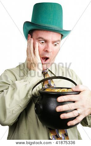 Irish man dressed as leprechaun, excited to be getting a pot of gold coins.  White background.