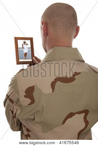 Conscript  marine looks at the photo of the girlfriend isolated over a white background