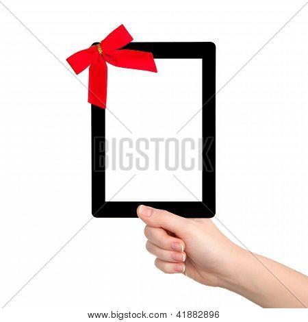 Female Hands Holding A Tablet With Isolated Screen And A Red Gift Bow