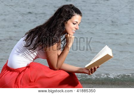 Woman Feeling Tranquility Reading A Book