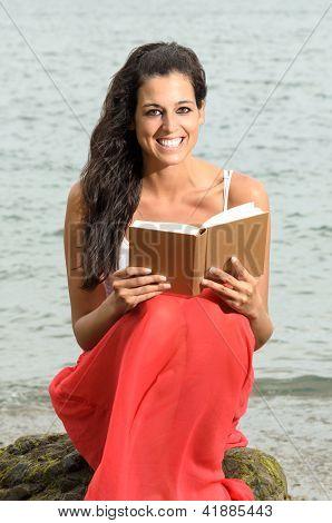 Woman Happy Reading Book Near The Sea