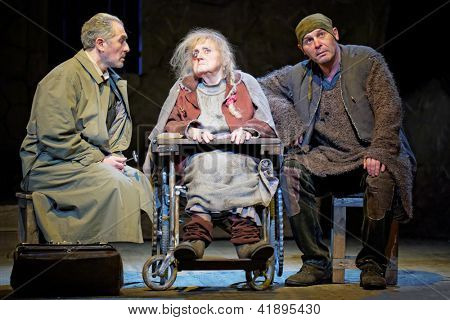 MOSCOW - JAN 18: Actors Marina Politsemaiko, Igor Pekhovych and Sergey Trifonov on stage of Taganka Theatre in performance  The Cripple from Inishmaan, Jan 18, 2012, Moscow, Russia.
