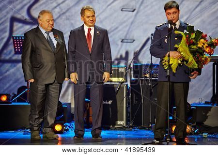 MOSCOW - JAN 23: Pilot-cosmonaut Georgy Grechko, Minister of Defence of Russia Sergei Shoigu, and ship Arabella captain Roman Lizalin at award ceremony Own Track, Jan 23, 2012, Moscow, Russia.