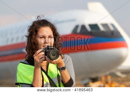 MOSCOW - SEP 1: Female participant of spotting at airport Domodedovo, Sep 1, 2011, Moscow, Russia. Spotting organized by press service of Domodedovo airport with airline UTair.