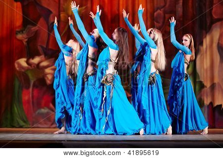 MOSCOW - JAN 28: Dancing collective in blue suits dances on stage of Red October Culture Palace during Bellydance Superiority of Moscow, Jan 28, 2012, Moscow, Russia.