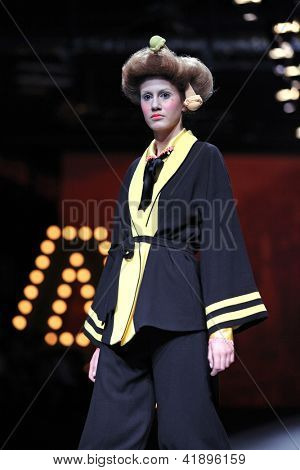 ZAGREB, CROATIA - OCTOBER 19: Fashion model wears clothes made by Borna & Fils at 'Croaporter' fashion show, on October 19, 2012 in Zagreb, Croatia.