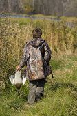 stock photo of hunt-shotgun  - Boy out duck hunting on a nice autumn day - JPG