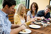 foto of party people  - Four young adults having a dinner party together - JPG