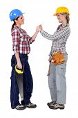 stock photo of friendship belt  - Happy female manual workers - JPG