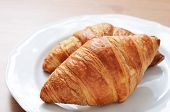 Two Fresh Croissant On A Plate