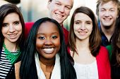 stock photo of mating  - Group of diverse students outside smiling together - JPG