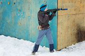 foto of cap gun  - boy in winter clothes with a machine gun to play laser tag - JPG