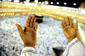 stock photo of kaaba  - Muslim Arabic man praying at Kaaba in Mecca - JPG