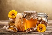 stock photo of honeycomb  - Still life with honey honeycomb pollen and propolis - JPG