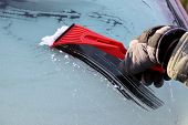 pic of car-window  - Scraping ice from the car window with copy space - JPG