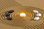 image of field_stone  - zen garden with candle light and stones of yin and yang
