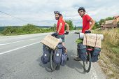 MOSTAR, BOSNIA - AUGUST 14: Young cyclists touring from Madrid to Istanbul on August 14, 2012 near M