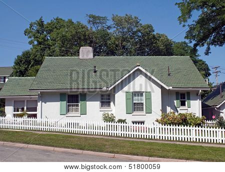 Green & White Cottage with Picket Fence