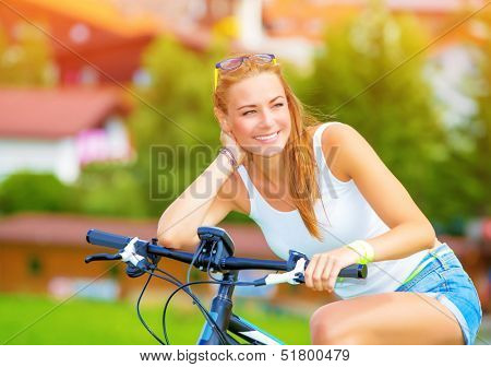 Happy woman traveling on bicycle along Europe, active lifestyle, enjoying riding on pushbike, summer adventure, travel and tourism concept